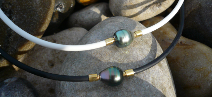 Tahiti pearls set as interchangeable clasps on black and white rubber necklaces