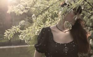 Julia is wearing a white australia pearl on a black nylon necklace